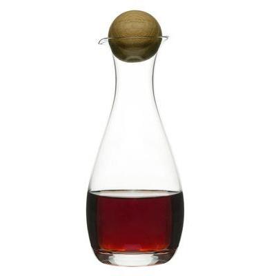 Lahjapakkaukseen pakattu öljy- ja viinietikkapullo, jotka on valmistettu suupuhallutetusta lasista ja korkki tammesta.